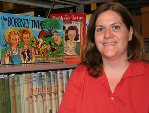 Danielle Culpepper with RBS's collection of Bobbsey twin series books